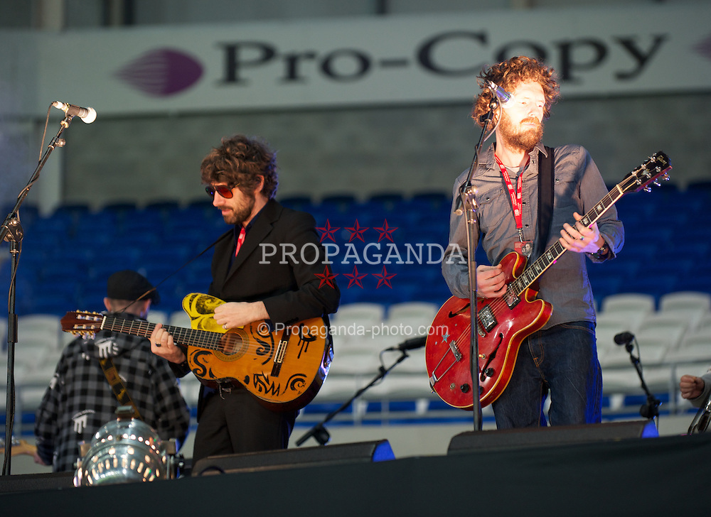CARDIFF, WALES - Wednesday, February 29, 2012: Gruff Rhys of the Super Furry Animals performs before the Gary Speed Memorial International Match between Wales and Costa Rica at the Cardiff City Stadium. (Pic by David Rawcliffe/Propaganda)