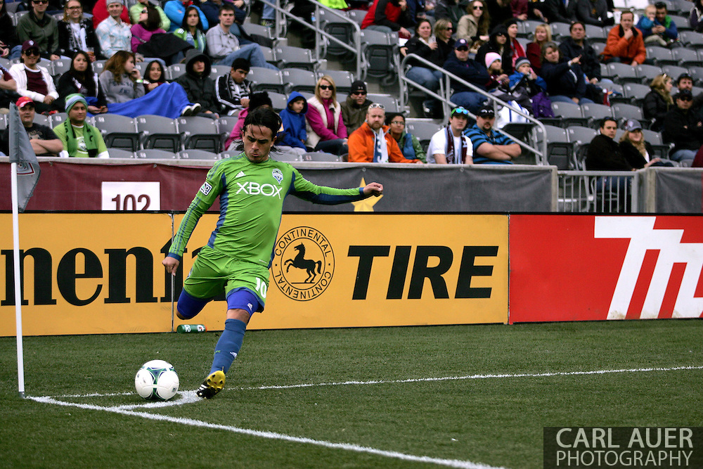 April 20th, 2013 Commerce City, CO - Seattle Sounders FC midfielder Mauro Rosales (10) attempts a corner kick in the second half of action in the MLS match between the Seattle Sounders FC and the Colorado Rapids at Dick's Sporting Goods Park in Commerce City, CO