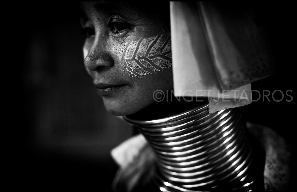 Awarded at IPA 2013<br /> Honorable Mention<br /> Cat. Professional | Editorial | Photo Essay and Feature Story<br /> <br /> <br /> The Kayan are an ethnic minority of Burma (Myanmar). The Kayan Lahwi is the group whose women identify themselves by wearing large neck rings, brass coils that are placed around the neck.<br /> Girls first start to wear rings when they are around five years old. Over the years the coil is replaced by a longer one and more turns are added. (some can weigh around 5 kg).<br /> <br /> The Kayan live in the hills in Northern Thailand in the provence of Mae Hong Son. In the late 1980's due to a conflict with the military regime in Burma, many Kayan tribes fled to the Thai border. Among the refugee camps set up there was a Long neck section, which became a tourist site, self-sufficient on tourist revenue and not needing financial assistance.<br /> Nai Soi, Mae Hong Son, Thailand<br /> &copy;Ingetje Tadros
