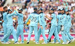 England celebrate the wicket of Quinton de Kock during the ICC Cricket World Cup group stage match at The Oval, London.