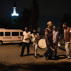 The area where each Ramadan drummer works is clearly marked and known to each drummer. In this photo Yağup Kapcak runs into other drummers in a street in between two areas.