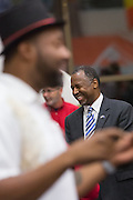 Retired Neurosurgeon and Republican presidential candidate Dr. Ben Carson enjoys Christmas carols with patients and staff during a visit to the MUSC Children's Hospital December 22, 2015 in Charleston, South Carolina. Carson stopped by to listen to Christmas carols and greet the young patients.