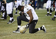 New Orleans Saints offensive tackle Terron Armstead (72) kneels and takes a private moment after the NFL NFC Wild Card football game against the Philadelphia Eagles on Saturday, Jan. 4, 2014 in Philadelphia. The Saints won the game 26-24. ©Paul Anthony Spinelli