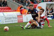 Doncaster Rovers defender Mitchell Lund (2) and Blackpool defender Luke Higham (24)  tangle for the ball  during the Sky Bet League 1 match between Doncaster Rovers and Blackpool at the Keepmoat Stadium, Doncaster, England on 28 March 2016. Photo by Simon Davies.