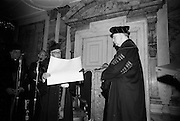 19/05/1966<br /> 05/19/1966<br /> 19 May 1966<br /> President Eamon de Valera receives Honorary Doctorate from the University of Louvain, Belgium at a conferring ceremony at the Department of External Affairs in Dublin. Picture shows  Right Reverend  Monsignor Louis De Raeymaeker,  Pro-Rector of The University of Louvain  conferring the honorary doctorate on President de Valera.