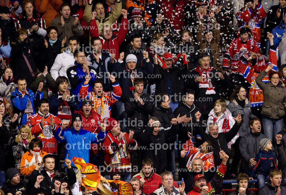Fans of Jesenice celebrate during  ice-hockey match between HK Acroni Jesenice and EV Vienna Capitals of 44th Round of EBEL league, on January 30, 2011 in Arena Podmezkla, Jesenice, Slovenia. Acroni Jesenice defeated Vienna 4-3. (Photo By Vid Ponikvar / Sportida.com)
