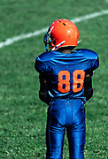 Young boys on the sideline of a Pop Warner football game, USA.