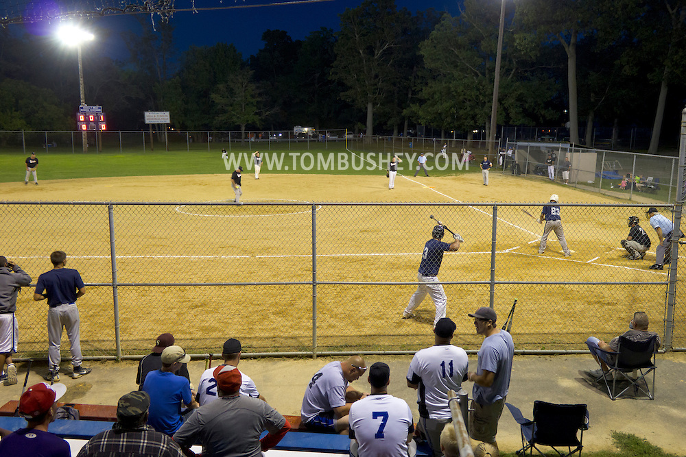 Middletown, New York - People watch a softball tournament at Fancher-Davidge Park on Saturday, Aug. 18, 2012.