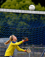 11 MAY 2012 -- ALTON, Ill. -- Civic Memorial High School soccer goalie Addie Ballard reaches for a shot by Alton Marquette High School during the Class 1A Regional Finals at Gordon Moore Park in Alton Friday, May 11, 2012. Photo © copyright 2012 Sid Hastings.