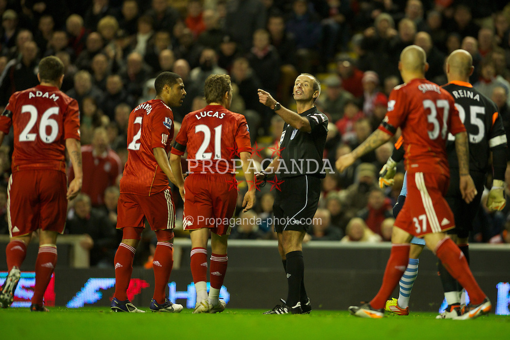 LIVERPOOL, ENGLAND - Sunday, November 27, 2011: Referee Martin Atkinson calls over Liverpool's Charlie Adam during the Premiership match against Manchester City at Anfield. (Pic by David Rawcliffe/Propaganda)