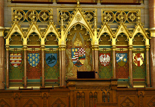 Hungarian Parliament interior; House of Lords; colorful crests in ornate wall; Budapest; Hungary