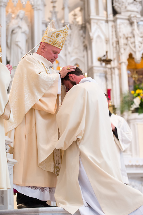 DENVER, CO - MAY 16: Denver Archbishop Samuel Aquila lays hands on the Rev. Joseph Marc McLagan during an ordination for priests in the Archdiocese of Denver at the Cathedral Basilica of the Immaculate Conception on May 16, 2015, in Denver, Colorado. (Photo by Daniel Petty/Denver Catholic Register)