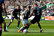 Ruben Lameiras (11) of Plymouth Argyle is tackled in the penalty area after being challenged by Matt Clarke (5) of Portsmouth during the EFL Sky Bet League 1 match between Plymouth Argyle and Portsmouth at Home Park, Plymouth, England on 14 April 2018. Picture by Graham Hunt.