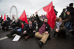 © licensed to London News Pictures. London, UK 21/11/2012. Students sitting on Westminster Bridge as students and members of the NUS (National Union of Students) march through central London to protest against government cuts to further and higher education, on November 21, 2012. Photo credit: Tolga Akmen/LNP