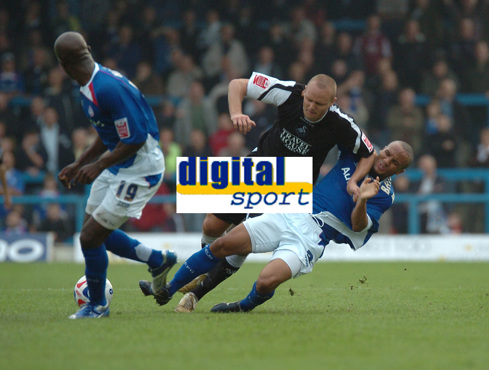 Photo: Ian Hebden.<br />Chesterfield United v Swansea City. Coca Cola League 1. 14/10/2006.<br />Swanseas Lee Trundle (C) and Chesterfields Alex Bailey (R) clash while Chesterfields Reuben Hazell (L) looks on.