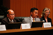 Richard Tran, center, talks during the Milpitas City Council Forum at Milpitas City Hall in Milpitas, California, on October 9, 2014. (Stan Olszewski/SOSKIphoto)