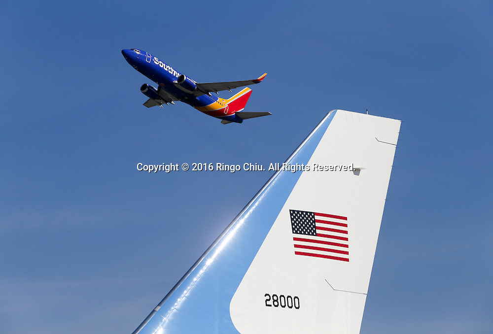A Southwest Airline aircraft flies past Air Force One sitting on the tarmac before President Barack Obama boarding at Los Angeles International Airport in Los Angeles, Friday, Feb 12, 2016.(Photo by Ringo Chiu/PHOTOFORMULA.com)<br /> <br /> Usage Notes: This content is intended for editorial use only. For other uses, additional clearances may be required.