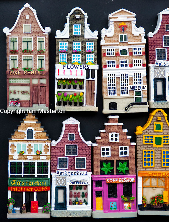 Many fridge magnets in shape of traditional dutch houses in Amsterdam Netherlands