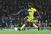 Ellis Harrison (22) of Portsmouth battles for possession with Anthony Stewart (5) of Wycombe Wanderers during the EFL Sky Bet League 1 match between Portsmouth and Wycombe Wanderers at Fratton Park, Portsmouth, England on 26 December 2019.