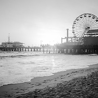 Santa Monica Pier black and white picture with Santa Monica Beach and the Pacific Ocean. Santa Monica Pier is a landmark that has an amusement park with a ferris wheel, roller coaster, restaurants, and other attractions.  Image Copyright © 2012 Paul Velgos with All Rights Reserved.