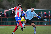 Dorking Wanderers Dean Hamlin claims the ball against Lewes FC Jonte Smith during the Ryman League - Div One South match between Dorking Wanderers and Lewes FC at Westhumble Playing Fields, Dorking, United Kingdom on 28 January 2017. Photo by Jon Bromley.