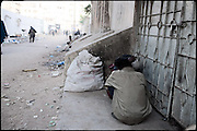 "Two heroin smokers share a dose of drug hid from the people away of the main road. Karachi, Pakistan, on friday, December 05 2008.....""Pakistan is one of the countries hardest hits by the narcotics abuse into the world, during the last years it is facing a dramatic crisis as it regards the heroin consumption. The Unodc (United Nations Office on Drugs and Crime) has reported a conspicuous decline in heroin production in Southeast Asia, while damage to a big expansion in Southwest Asia. Pakistan falls under the Golden Crescent, which is one of the two major illicit opium producing centres in Asia, situated in the mountain area at the borderline between Iran, Afghanistan and Pakistan itself. .During the last 20 years drug trafficking is flourishing in the Country. It is the key transit point for Afghan drugs, including heroin, opium, morphine, and hashish, bound for Western countries, the Arab states of the Persian Gulf and Africa..Hashish and heroin seem to be the preferred drugs prevalence among males in the age bracket of 15-45 years, women comprise only 3%. More then 5% of whole country's population (constituted by around 170 milion individuals),  are regular heroin users, this abuse is conspicuous as more of an urban phenomenon. The substance is usually smoked or the smoke is inhaled, while small number of injection cases have begun to emerge in some few areas..Statistics say, drug addicts have six years of education. Heroin has been identified as the drug predominantly responsible for creating unrest in the society."""
