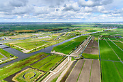 Nederland, Zuid-Holland, Leiderdorp, 28-04-2017; Boortunnel onder het Groene Hart van de hogesnelheidslijn (HSL-Zuid). Polder Achthoven met luchtschacht van de tunnel die de drukgolf van de treinen opvangt.<br /> Drilled tunnel of the High Speed Train (HSL) under so-called the Green Heart, with the air shaft of the tunnel that enables the pressure wave of the trains to escape. <br /> luchtfoto (toeslag op standard tarieven);<br /> aerial photo (additional fee required);<br /> copyright foto/photo Siebe Swart