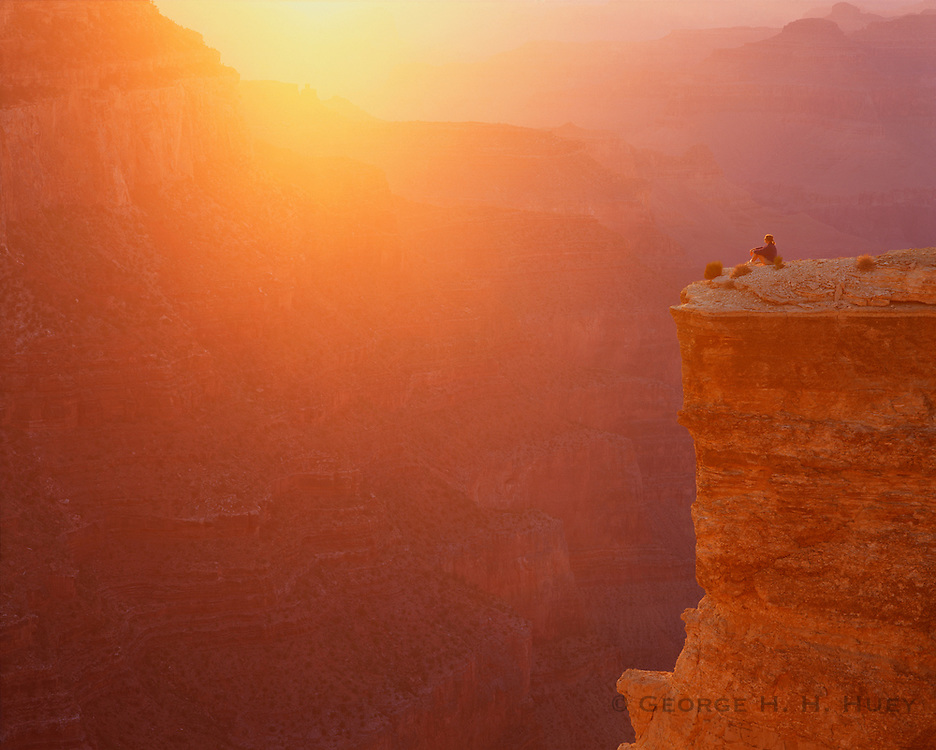 0107-1105D ~ Copyright: George H. H. Huey ~ Hiker at Yaki Point.  Sunset. Grand Canyon National Park. Arizona.