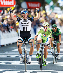 Marcel Kittel of Germany and Team Giant-Shimano celebrates as he wins the sprint across the line in Harrogate to win Stage 1 of the Tour de France, with home favourite Mark Cavendish haven taken a fall in the closing stages - Photo mandatory by-line: Rogan Thomson/JMP - 07966 386802 - 05/07/2014 - SPORT - CYCLING - Harrogate, North Yorkshire - Le Tour de France Grand Depart Stage 1, Leeds to Harrogate.