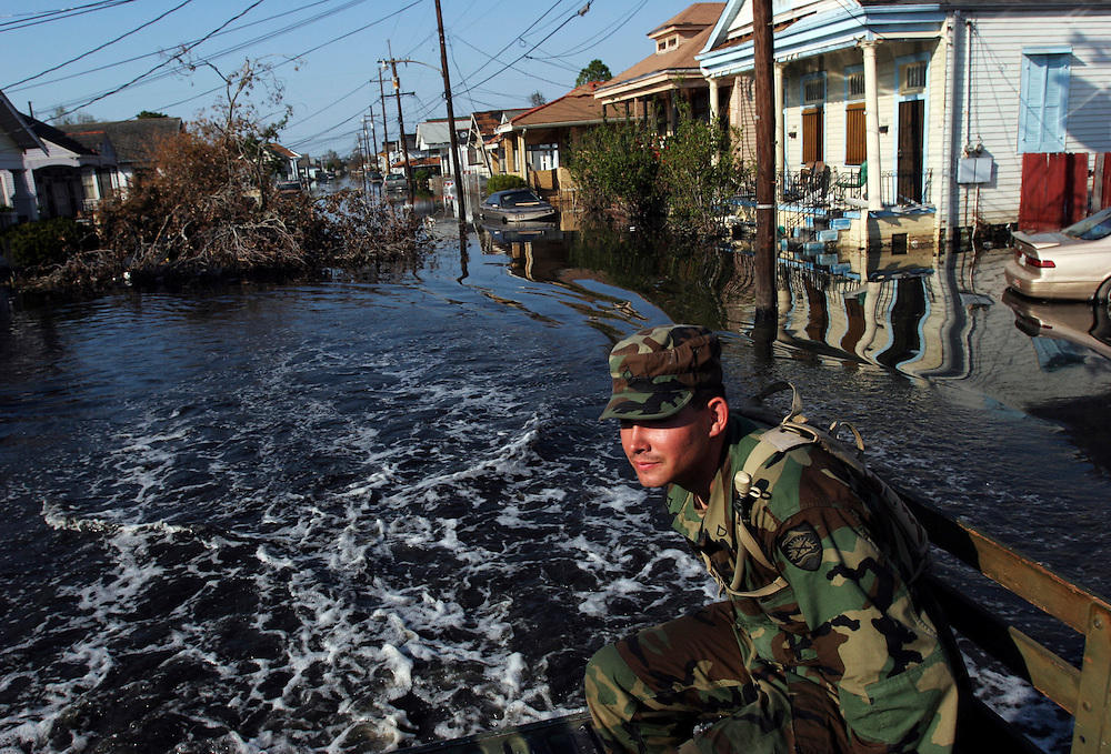 PFC Donald Epperson (right) and other guardsmen search for survivors in the flooded streets and homes of New Orleans. Oregon National Guard troops work in New Orleans after the wrath of Hurricane Katrina. Photographed September 8, 2005. (Thomas Patterson / Statesman Journal)