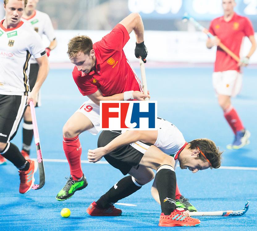 BHUBANESWAR - The Odisha Men's Hockey World League Final . Match ID 01 . Germany v England (2-0).  David Goodfield (Eng) with Marco Miltkau (Ger)  .WORLDSPORTPICS COPYRIGHT  KOEN SUYK