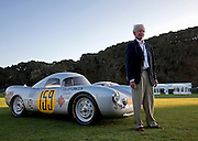 Image of the director of the Porsche Race Car Classic standing next to Jerry Seinfeld's Porsche 550-03 Spyder, Quail Lodge, Carmel, California, America west coast.
