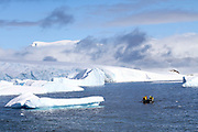 Cuverville Island or Île de Cavelier de Cuverville is a dark, rocky island lying in Errera Channel between Arctowski Peninsula and the northern part of Rongé Island, off the west coast of Graham Land in Antarctica.