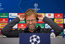 LIVERPOOL, ENGLAND - Tuesday, November 26, 2019: Liverpool's manager Jürgen Klopp listens to a translation on headphones during a press conference at Anfield ahead of the UEFA Champions League Group E match between Liverpool FC and SSC Napoli. (Pic by David Rawcliffe/Propaganda)