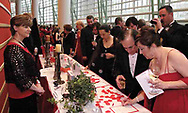 Mr. & Mrs. Paul Ginsburg, from Centerville (right) add a bid during the silent auction at the 2007 Wellness Connection Red Dress Gala, at the Schuster Performing Arts Center in Dayton, Saturday night, May 5th.