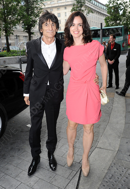 04.JULY.2012. LONDON<br /> <br /> RONNIE WOOD AND SALLY HUMPPHREYS ATTEND THE ARQIVA RADIO AWARDS HELD AT THE PARK PLAZA IN LONDON.<br /> <br /> BYLINE: EDBIMAGEARCHIVE.CO.UK<br /> <br /> *THIS IMAGE IS STRICTLY FOR UK NEWSPAPERS AND MAGAZINES ONLY*<br /> *FOR WORLD WIDE SALES AND WEB USE PLEASE CONTACT EDBIMAGEARCHIVE - 0208 954 5968*
