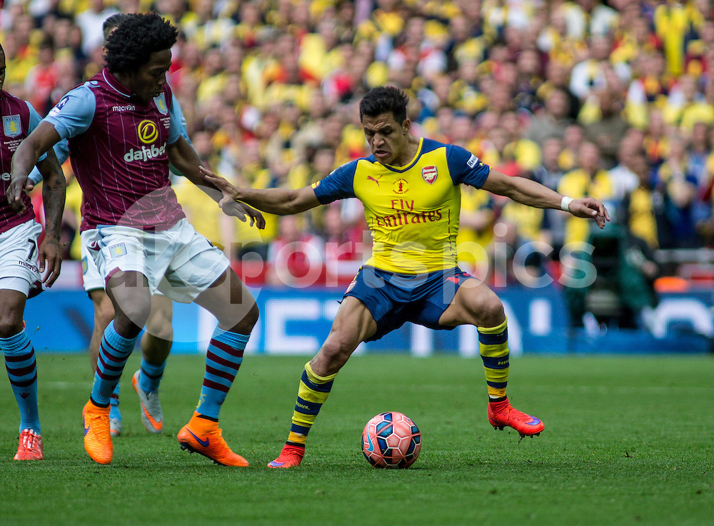 Alexis Sanchez of Arsenal tries to go around Carlos Sanchez of Aston Villa during the The FA Cup Final match between Arsenal and Aston Villa at Wembley Stadium, London, England on 30 May 2015. Photo by Liam McAvoy.