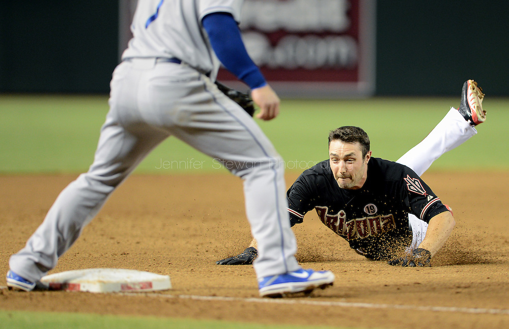 Jul 10, 2013; Phoenix, AZ, USA;  Arizona Diamondbacks outfielder A.J. Pollock (11) slides safely into third after hitting a triple against the Los Angeles Dodgers in the third inning at Chase Field. Mandatory Credit: Jennifer Stewart-USA TODAY Sports