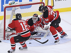 June 9, 2012; Newark, NJ, USA;  New Jersey Devils defenseman Anton Volchenkov (28) and New Jersey Devils right wing Steve Bernier (18) look for the rebound after a save by New Jersey Devils goalie Martin Brodeur (30) during the first period of Game 5 of the 2012 Stanley Cup Finals at the Prudential Center.