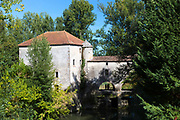 Tourists visiting picturesque traditional Moulin de Loubens, 19th Century water mill, in Gironde, France