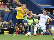 Oxford United forward Ryan Taylor (20) skips past a tackle during the Sky Bet League 2 match between Oxford United and AFC Wimbledon at the Kassam Stadium, Oxford, England on 10 October 2015.
