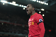Georginio Wijnaldum (Liverpool) roars to the fans as his cross provides Divock Origi (Liverpool) the opportunity to score Liverpool's second goal of the game. 2-1 to the home side during the Premier League match between Liverpool and Bournemouth at Anfield, Liverpool, England on 5 April 2017. Photo by Mark P Doherty.