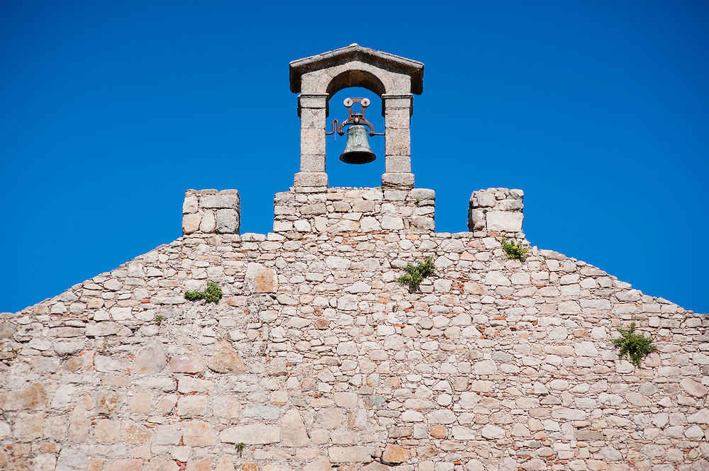 Medieval wall with bell in Trujillo (Spain)