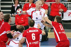 Karol Bielecki (8) of Poland vs Lasse Svan Hansen of Denmark during 21st Men's World Handball Championship 2009 Bronze medal match between National teams of Poland and Denmark, on February 1, 2009, in Arena Zagreb, Zagreb, Croatia.  (Photo by Vid Ponikvar / Sportida)