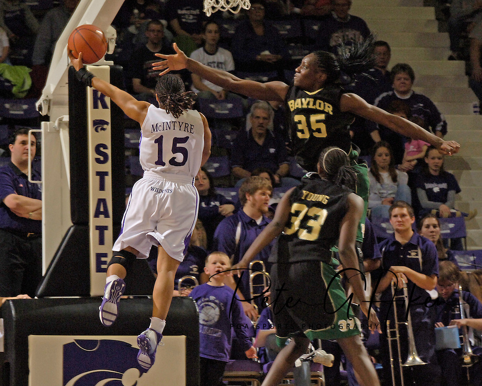 Kansas State's Twiggy McIntyre (15) scores past Baylor's Abiola Wabara (35) and Sophia Young (33), during the second half at Bramlage Coliseum in Manhattan, Kansas, February 25, 2006. The 10 ranked Lady Bears defeated K-State 79-70.