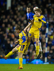 LIVERPOOL, ENGLAND - Thursday, December 17, 2009: Everton's Shane Duffy and FC BATE Borisov's Vitali Radzionau during the UEFA Europa League Group I match at Goodison Park. (Pic by David Rawcliffe/Propaganda)