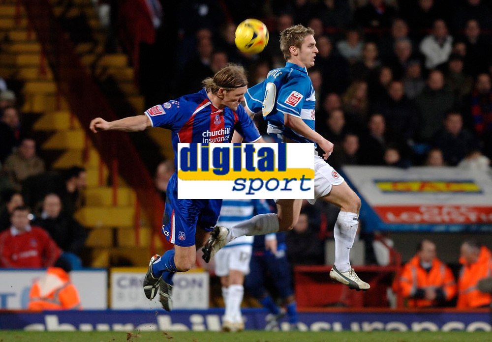 Photo: Daniel Hambury.<br />Crystal Palace v Reading. Coca Cola Championship.<br />20/01/2006.<br />Palace's Darren Ward and Reading's Kevin Doyle battle for the ball.