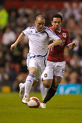 Manchester, England - Tuesday, March 13, 2007:  Europe XI's Stelios Giannakopoulos in action against Kieran Richardson during the UEFA Celebration Match at Old Trafford. (Pic by David Rawcliffe/Propaganda)