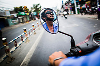 A motorbike taxi driver on the streets of Ho Chi Minh City, Vietnam.