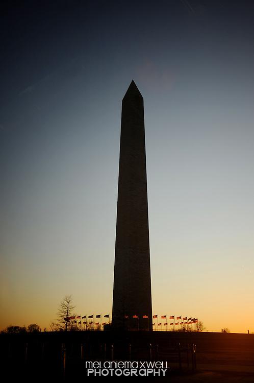 The sun sets on the Washington monument in Washington, D.C., in December, 2012. Melanie Maxwell